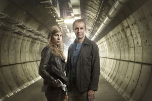 Clemence Poesy (Elise Wassermann) and Stephen Dillane (Karl Roebuck) standing in the centre of a tunnel