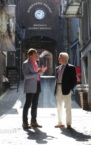 Michael Portillo, John Owen in front of the entrance to Shepherd Neame brewery