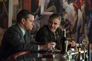 Frank Stokes (George Clooney) and James Granger (Matt Damon) are in their WW2 having a drink at a bar. Clooney is smiling at a more anxious looking Damon.