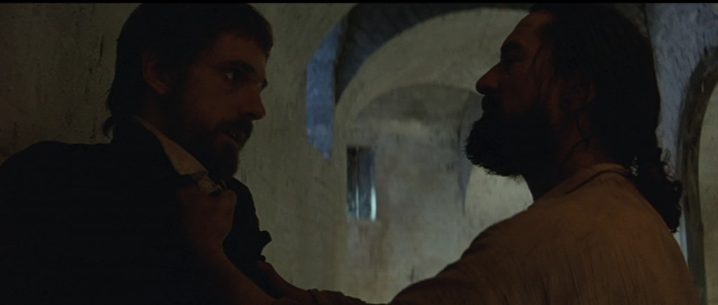 Mendoza (Robert De Niro) holding Father Gabriel (Jeremy Irons)up by the collar in confrontation