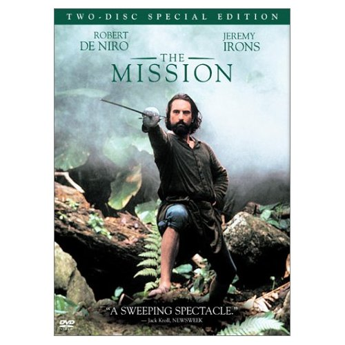 The Mission DVD cover- Robert De Niro standing on tree branches and rocks pointing a sword at the camera. The mission written in green.