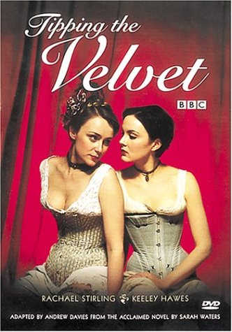 Tipping the Velvet dvd cover- two ladies dressed in corsets sat next to each other in front of a red curtain. Tipping the Velvet written in white on top
