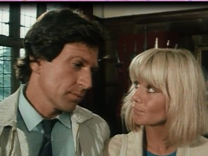 Dempsey (Michael Brandon) and Makepeace (Glynis Barber) facing each other inside Chilham Castle