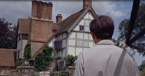 a man standing facing Gabriel's Manor in Edenbridge- a tutor style house with lots of chimneys