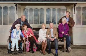 The Boomers cast sitting on a bench - Joan (JUNE WHITFIELD), John (RUSS ABBOT), Maureen (STEPHANIE BEACHAM), Carol (PAULA WILCOX), Trevor (JAMES SMITH), Joyce (ALISON STEADMAN), Alan (PHILIP JACKSON) C BBCHattrickJack Barnes