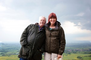 Taste of Britain presenters Brian Turner and Janet Street Porter standing in the countryside smiling at the camera