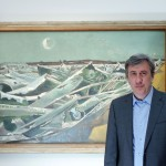 Artists of War presenter Andrew Graham-Dixon in front of a Paul Nash painting