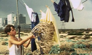 The Garden screenshot - a boy putting washing out in Dungeness estate