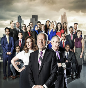 The Apprentice contestants with Karren Brady, Lord Alan Sugar and Nick Hewe in front of them. Skyline of London in background