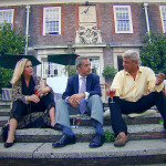 Steph and Dom sitting outside their home with Nigel Farage