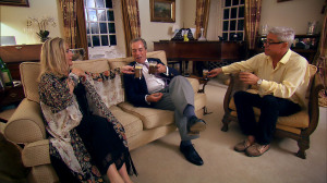 Steph and Dom enjoying drinks with Nigel Farage in their living room