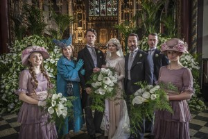 The cast of Mr Selfridge pose for a wedding photo in a church