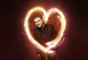 Paddy McGuinness standing in a light shaped like a heart
