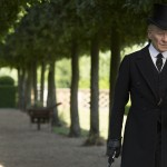 Mr. Holmes walking along a tree lined path