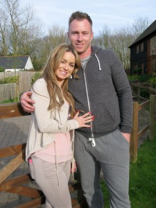 Ola and James Jordan standing in their garden