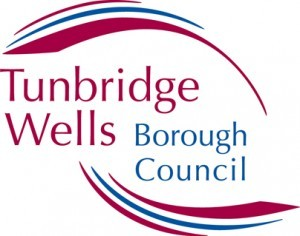Tunbridge Wells Borough Council Logo- Tunbridge Wells written in pink with Borough Council written in blue underneath. Writing surrounded by blue and pink curves. Links to Their website.