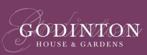 Godinton House and Gardens Logo- Godinton House and Gardens written in white on a purple background. Links to Their website.