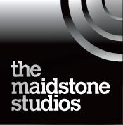 The Maidstone Studios Logo- The Maidstone Studios written in white on a black background. Links to Their website.