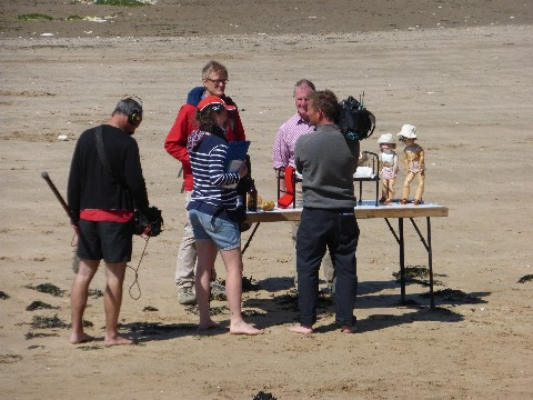 The Coast team on the sandy beach at Margate in front of a fold up table