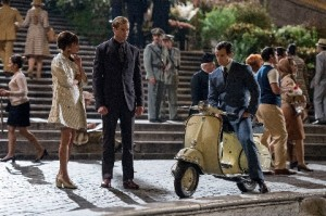 Alicia Vikander as Gaby, Armie Hammer as Illya Kuryakin and Henry Cavill standing outside a flight of stairs