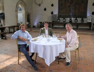 Mason McQueen, Philip Sidney and Terry Wogan at Penshurst Place sat on a round table with food
