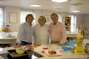 Mason McQueen, Rosemary Shrager, Terry Wogan at Rosemary's cooking school behind a counter of food
