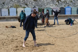 Behind the scenes in Ramsgate Mick Carter (DANNY DYER) on the beach in front of camera crew