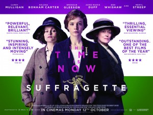 "Suffragette film poster- The three sufragetters facing the camera with ""The Time is Now"" ""Suffrafettes"" written on top"