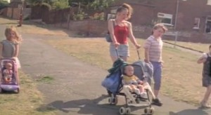 Wasp - Zoe a young mum walking with her children around an estate