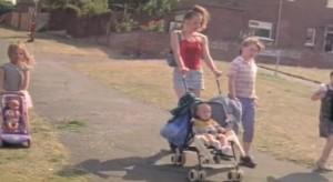 Wasp - Zoe walking with her children around an estate
