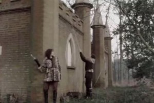 Blakes 7 Screenshot Quex Park – Waterloo Tower- two characters leabing against the stone wall