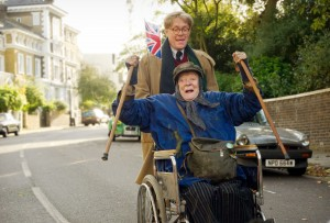 The Lady In The Van - Dame Maggie Smith as Miss Shepherd being pushed in a wheelchair by Alex Jennings as Alan Bennett
