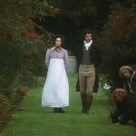 French and Saunders - Pride and Prejudice screenshot at Finchcocks - actors dressed in period costume wwalking through the garden with the homeowners in shot