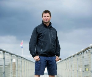 Presenter George Clarke standing on a bridge with metal railings