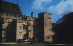 Penshurst Place entrance with driveway and trees. A car is parked in front