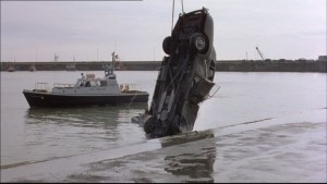 a car being pulled out of the water at Ramsgate Harbour- a boat is in the water behind