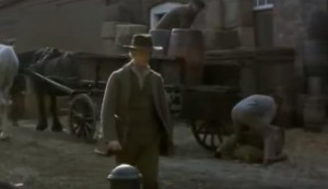 The Mill on the Floss screenshot at The Historic Dockyard Chatham - a man walking along a street with a horse and carriage behind him