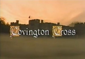 Covington Cross written in white with a picture of a castle at sunset behind