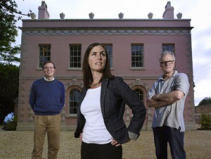 RESTORING BRITAIN'S LANDMARKS, Anna Keay, Alastair Dick-Cleland and John Evetts standing in front of a large building.