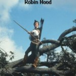 Robin Hood (George Segal) standing on a tree with a bow and arrow