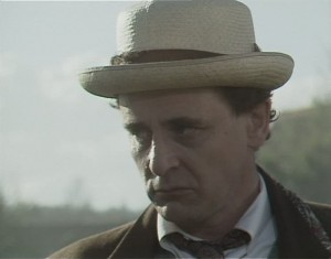 head shot of Sylvester McCoy as Doctor Who looking concerned, looking away from the camera