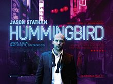 Hummingbrid Film Poster - actor in a tux in front of city lights at night, Hummingbird is written in neon blue lights