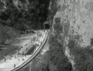 Screenshot from St John's Hole Quarry - aerial shot of people and daleks walking along a train track
