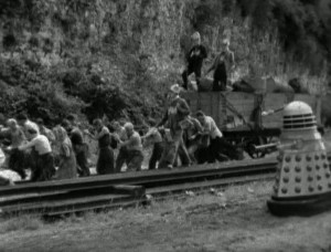 Screenshot from St John's Hole Quarry - people and daleks walking along a train track