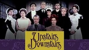 The cast of Upstairs, Downstairs standing behind a sign that reads Upstairs, Downstairs