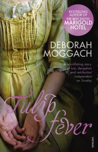 Tulip Fever book cover- image of a womens chest and arms dressed in a yellow period dress. Tulip Fever is written in Pink, the the writer's name Deborah Moggach written in white above. Links to book website.