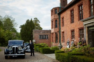 Churchill's Secret at Chartwell - a car outside the house with people waiting at the door