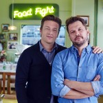 Jamie and Jimmy standing in their cafe