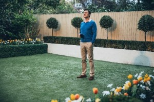 Jon (David Morrissey) standing in a garden