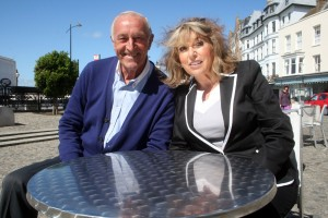 Holiday of My Lifetime Series 2, Len Goodman and Eve Pollard sitting at a silver table in Margate